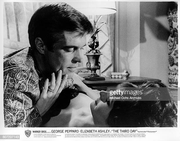 George Peppard an Elizabeth Ashley share a tender moment in a scene from the Warner Bros movie The Third Day circa 1965
