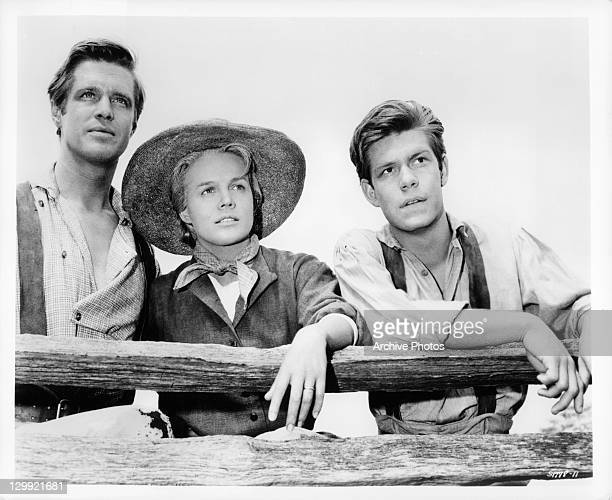 George Peppard Carroll Baker and Claude Johnson at their farm in the Ohio River Valley in a scene from the film 'How The West Was Won' 1962