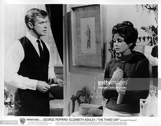 George Peppard defends himself after Elizabeth Ashley receives a letter in a scene from the Warner Bros movie The Third Day circa 1965