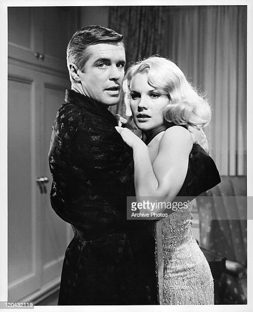 George Peppard embraces Carroll Baker in a scene from the film 'The Carpetbaggers' 1964