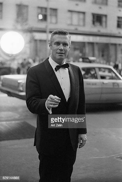 George Peppard in a tux arriving at an event; circa 1970; New York.