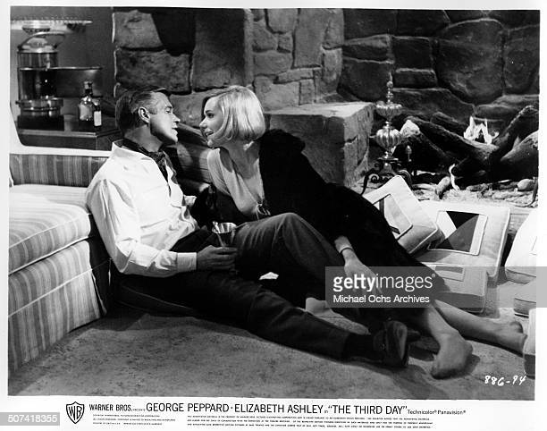 George Peppard shares a romantic moment with Sally Kellerman in a scene from the Warner Bros movie The Third Day circa 1965