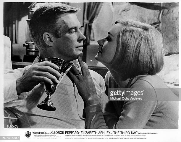 """George Peppard shares a romantic moment with Sally Kellerman in a scene from the Warner Bros. Movie """"The Third Day"""", circa 1965."""