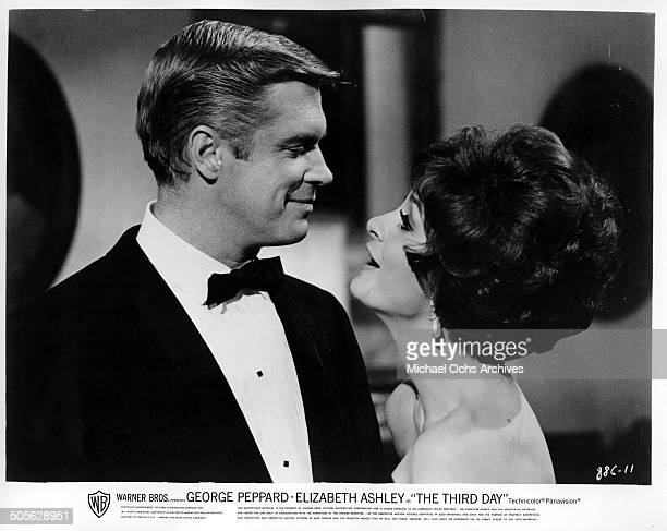 George Peppard smiles at Elizabeth Ashley in a scene from the Warner Bros movie The Third Day circa 1965