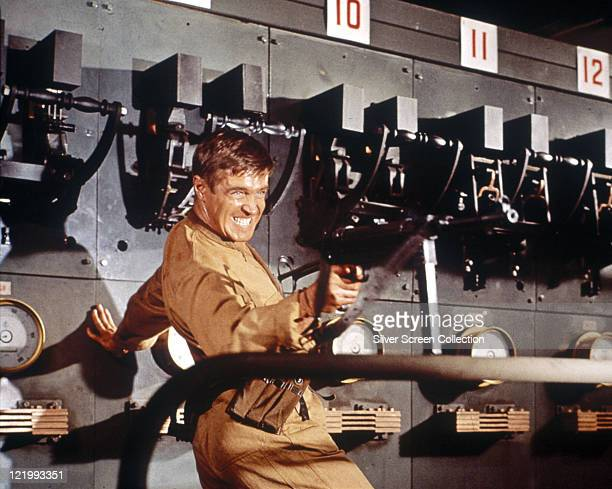 George Peppard , US actor, pointing a gun in a publicity still issued for the film , 'Operation Crossbow', 1965. The thriller, directed Michael...