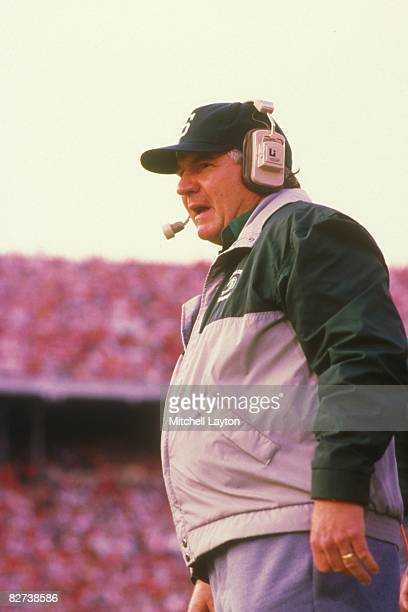 George Perles head coach of the Michigan State Spartans during a college football game against the Ohio State Buckeyes on October 31 1989 at Ohio...