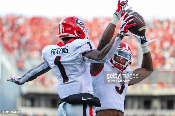 George Pickens celebrates his touchdown reception with Zamir White of the Georgia Bulldogs during the second half of the game against the Georgia...