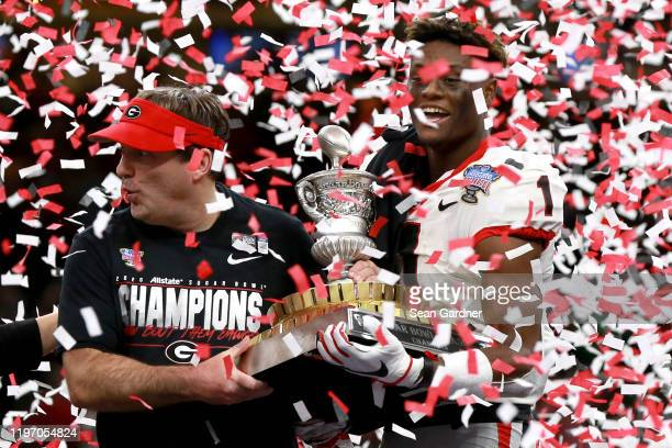 George Pickens of the Georgia Bulldogs and head coach Kirby Smart of the Georgia Bulldogs hold the Allstate Sugar Bowl trophy after defeating the...