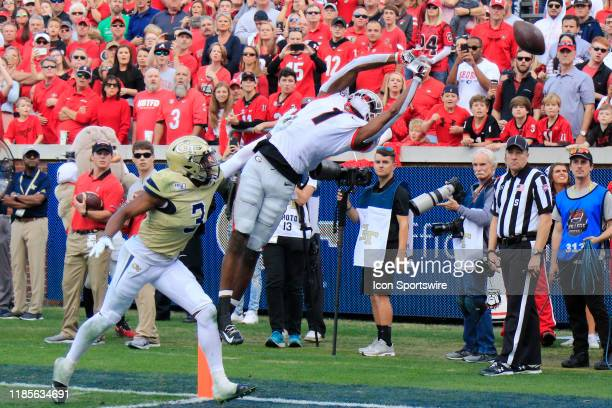 George Pickens of the Georgia Bulldogs leaps for the over thrown ball during the college football game between the Georgia Tech Yellow Jackets and...