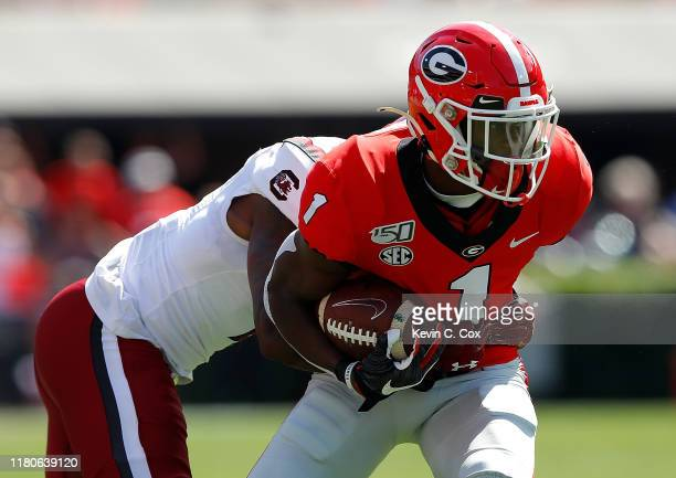 George Pickens of the Georgia Bulldogs pulls in this reception against Jaycee Horn of the South Carolina Gamecocks in the first half at Sanford...