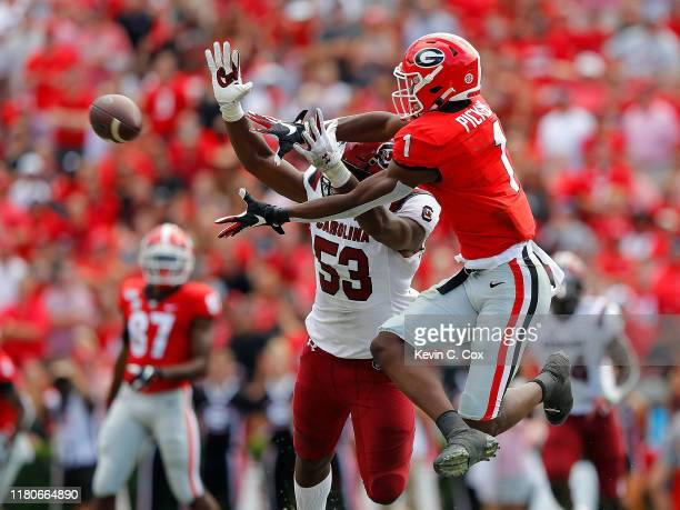 George Pickens of the Georgia Bulldogs pulls in this reception against Ernest Jones of the South Carolina Gamecocks in the second half at Sanford...