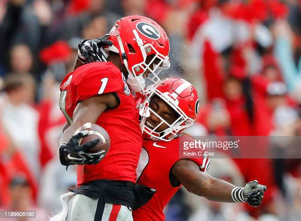 George Pickens of the Georgia Bulldogs reacts after pulling in a reception for a touchdown against the Texas A&M Aggies with Kearis Jackson in the...