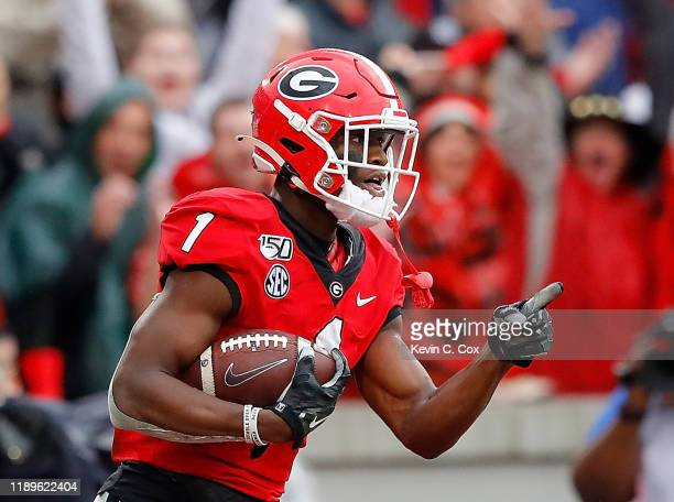 George Pickens of the Georgia Bulldogs reacts after pulling in a reception for a touchdown against the Texas A&M Aggies in the first half at Sanford...