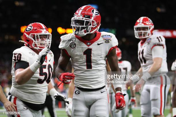 George Pickens of the Georgia Bulldogs reacts after scoring a touchdown against the Baylor Bears during the Allstate Sugar Bowl at Mercedes Benz...