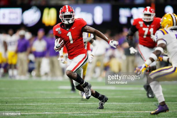 George Pickens of the Georgia Bulldogs runs with the ball in the second half against the LSU Tigers during the SEC Championship game at MercedesBenz...