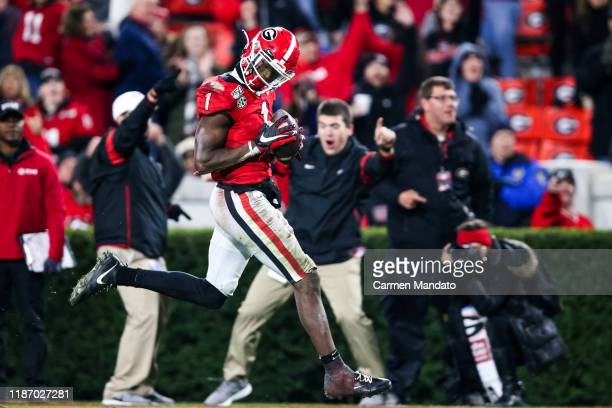 George Pickens of the Georgia Bulldogs rushes after a reception during a game against the Missouri Tigers at Sanford Stadium on November 9 2019 in...