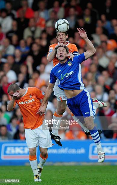 George Pilkington of Luton Town battles with Gareth Taylor of Wrexham during the Blue Square Premier League play off semefinal second leg match...