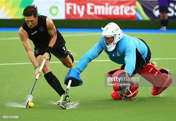 George Pinner of England stretches to stop Simon Child of New Zealand in the shoot out in the bronze medal match between New Zealand and England at...