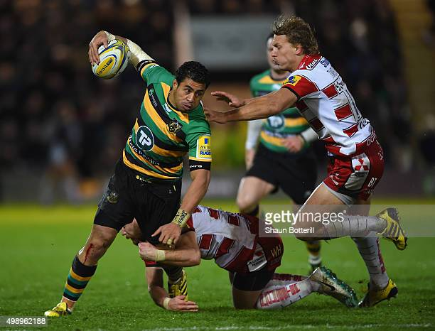 George Pisi of Northampton Saints is tackled by Willi Heinz and Billy Twelvetrees of Gloucester Rugby during the Aviva Premiership match between...