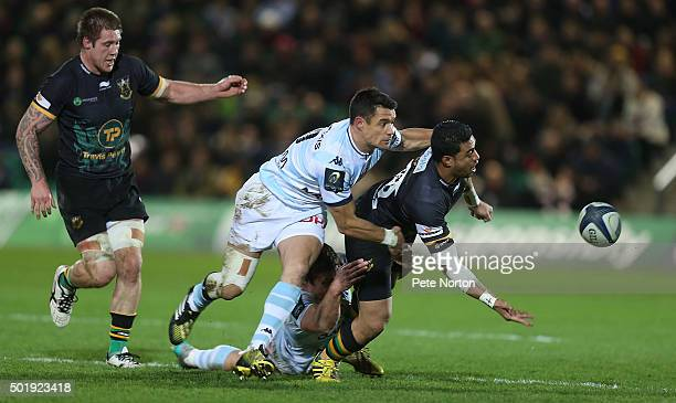George Pisi of Northampton Saints passes the ball under pressure from Dan Carter of Racing 92 during the European Rugby Champions Cup match between...
