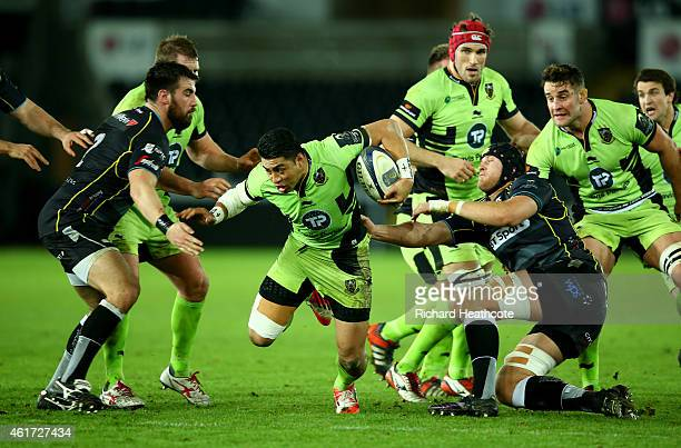George Pisi of Saints charges through during the European Rugby Champions Cup match between Ospreys and Northampton Saints at the Liberty Stadium on...