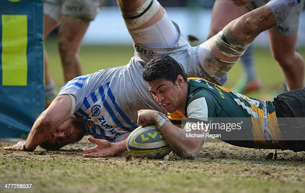 George Pisi scores his third try during the LV= Cup Semi Final match between Northampton Saints and Saracens at Franklin's Gardens on March 8 2014 in...