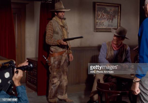 George Plimpton John Wayne Howard Hawks crew member behind the scenes of the making of 'Rio Lobo' for the ABC special 'Plimpton ShootOut at Rio Lobo'