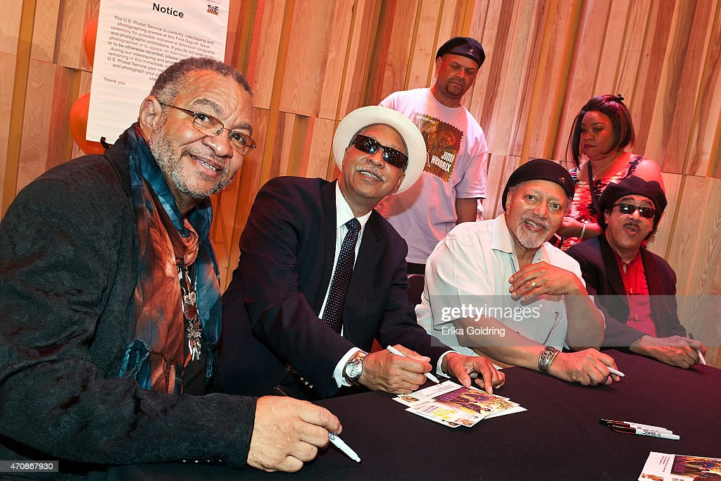 George Porter Jr, Joseph 'Zigaboo' Modeliste, Art Neville and Leo Nocentelli of the original The Meters sign envelopes during the Jazz Fest Postal Cachet unveiling at George and Joyce Wein Jazz & Heritage Center on April 23, 2015 in New Orleans, Louisiana.