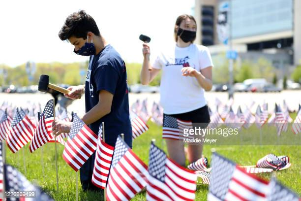 George Potenza of Foxborough plants a flag outside of Gillette Stadium on May 21 2020 in Foxborough Massachusetts The Patriots foundation partnered...
