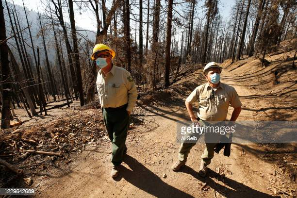 George Powell, left, Sequoia National Forest ecosystem manager and Eric La Price, right, Sequoia National Forest's Western Divide District ranger...