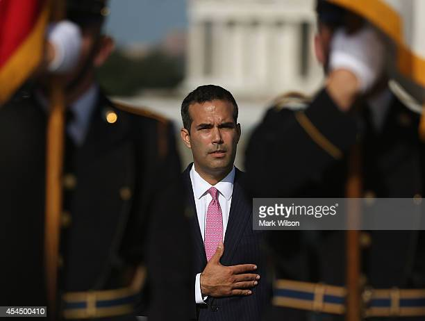 George Prescott Bush grandson of President George HW Bush participtes in a ceremony at the World War II Memorial September 2 2014 in Washington DC...