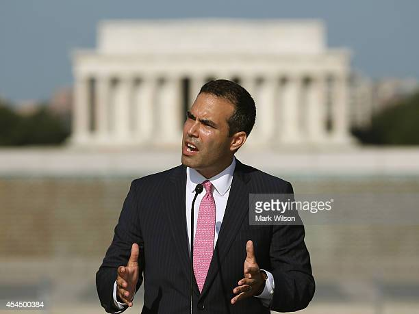 George Prescott Bush grandson of President George HW Bush speaks during a ceremony at the World War II Memorial September 2 2014 in Washington DC The...