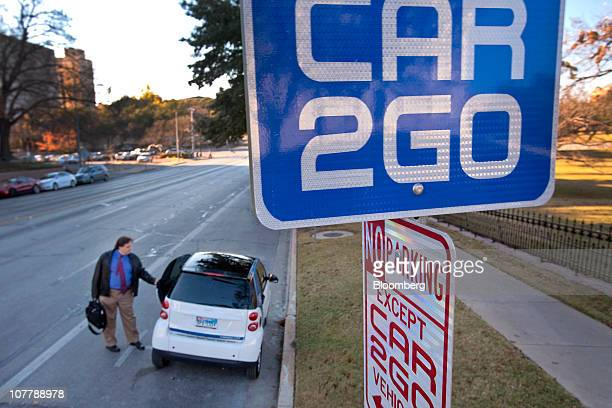 George Purcell Jr an analyst for the Texas Legislative Budget Board enters a Daimler AG Smart car that is part of the Car2go auto sharing program in...