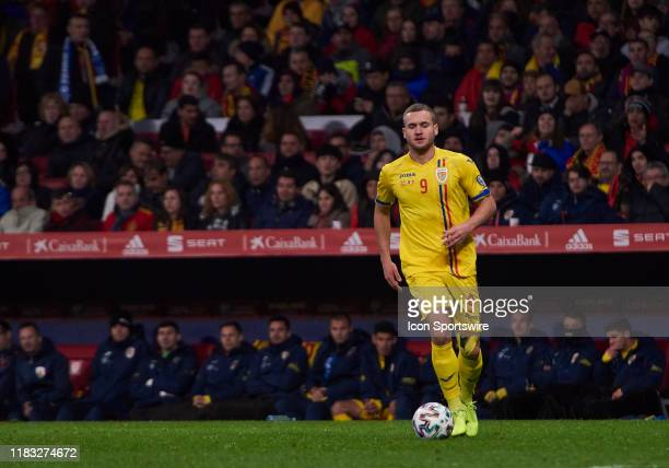 George Puscas, forward of Romania with the ball during the UEFA Euro 2020 Qualifier between Spain and Romania on November 18, 2019 in Madrid, Spain.