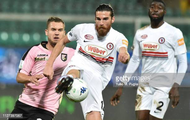 George Puscas of Palermo and Luca Martinelli of Foggia compete for the ball during the Serie B match between US Citta di Palermo and Foggia at Stadio...