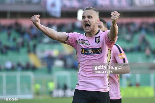 George Puscas of Palermo celebrates after scoring his team third goal during the Serie B match between US Citta di Palermo and Carpi FC at Stadio...