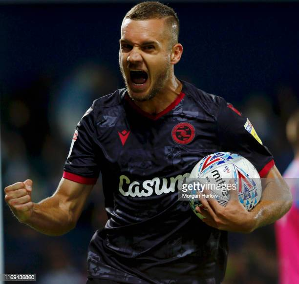 George Puscas of Reading celebrates after scoring their teams first goal during the Sky Bet Championship match between West Bromwich Albion and...
