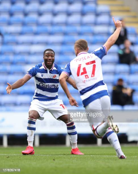 George Puscas of Reading celebrates with teammate Yakou Meite after scoring his sides first goal during the Sky Bet Championship match between...