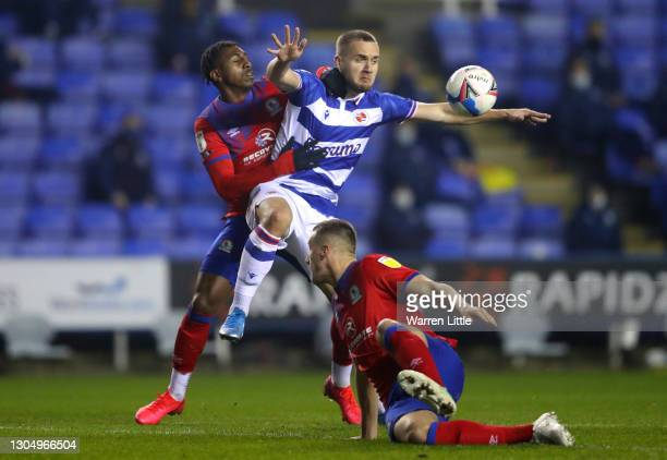 George Puscas of Reading FC is tackled by Amari'i Bell and Taylor Harwood-Bellis of Blackburn Rovers during the Sky Bet Championship match between...