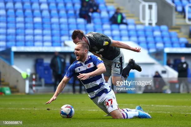 George Puscas of Reading is fouled by Julian Boerner of Sheffield Wednesday leading to Reading being awarded a penalty during the Sky Bet...