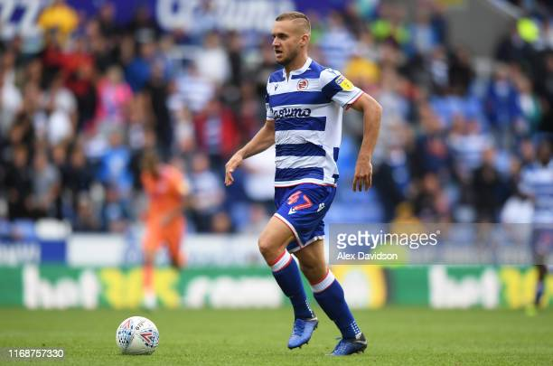 George Puscas of Reading makes a break during the Sky Bet Championship match between Reading and Cardiff City at Madejski Stadium on August 18, 2019...