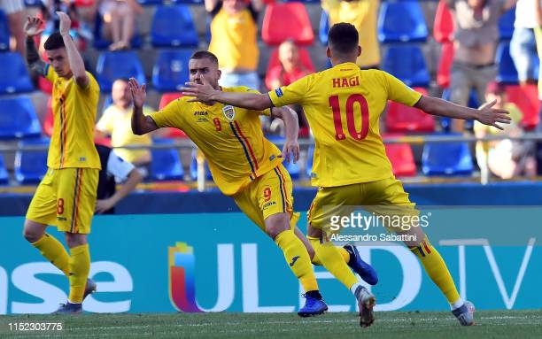 George Puscas of Romania celebrates after scoring his team second goal during the 2019 UEFA U21 SemiFinal match between Germany and Romania at Stadio...