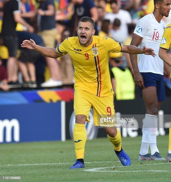 George Puscas of Romania celebrates after scoring the opening goal during the 2019 UEFA U-21 Group C match between England and Romania at Dino...