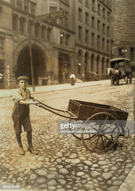 George Rabholz 14 years old Delivers Bundles for Printing Office Cincinnati Ohio USA Lewis Hine for National Child Labor Committee August 1908