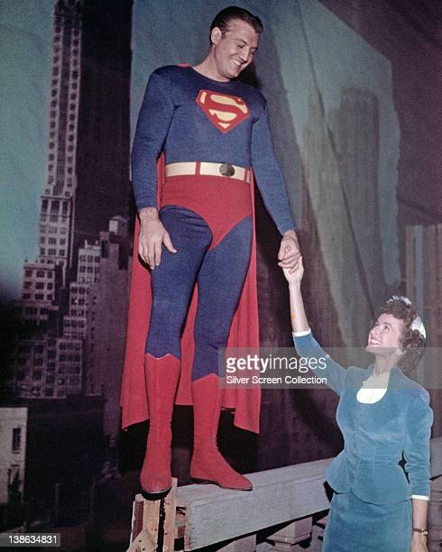 George Reeves US actor and Phyllis Coates US actress smile while holding hands in a publicity portrait issued for the US television series...
