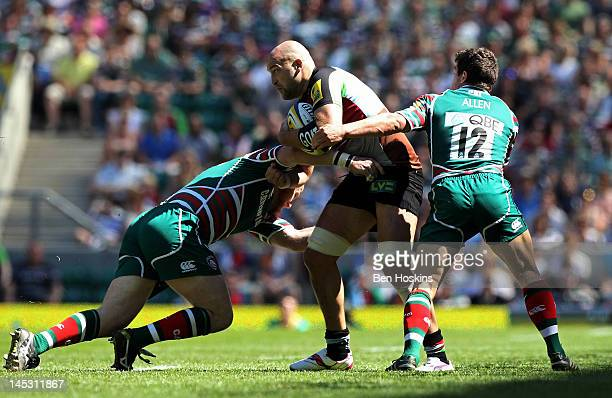 George Robson of Harlequins is tackled by Dan Cole and Anthony Allen of Leicester during the Aviva Premiership final between Harlequins and Leicester...