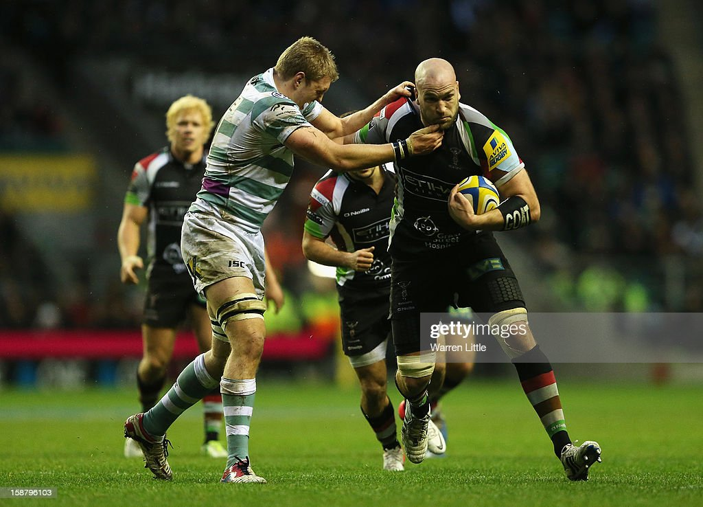 George Robson of Harlequins is tackled by Jamie Gibson of London Irish during the Aviva Premiership match between Harlequins and London Irish at Twickenham Stadium on December 29, 2012 in London, England.