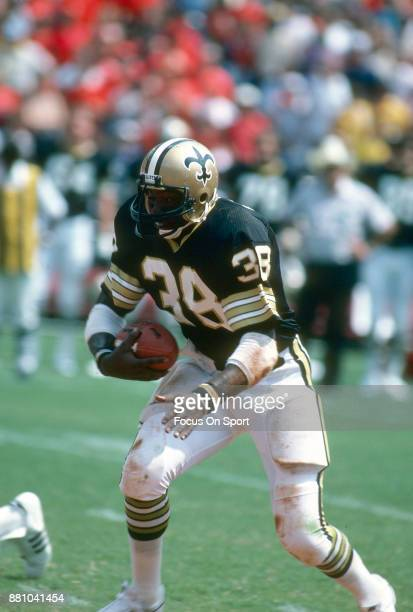George Rogers of the New Orleans Saints carries the ball against the Atlanta Falcons during an NFL football game at AtlantaFulton County Stadium...