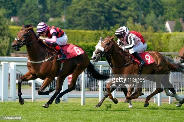 George Rooke riding Andaleep win The mber Court Handicap at Sandown Park Racecourse on July 22, 2021 in Esher, England.