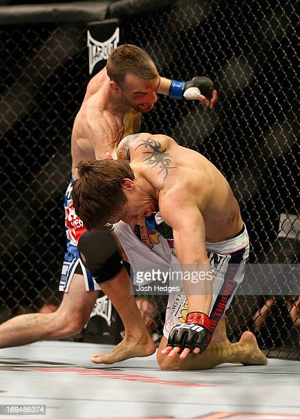George Roop punches Brian Bowles in their bantamweight bout during UFC 160 at the MGM Grand Garden Arena on May 25, 2013 in Las Vegas, Nevada.